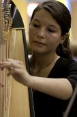 NEW YORK-JUL 28: A close up of harpist Emily Hopkins performing in Penn Station on July 28, 2012 in