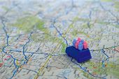 image of family vacations  - Toy car with toy people on map suggesting a family vacation - JPG