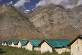 stock photo of manali-leh road  - Bamboo hut encampment on the mountain road between Manali and Leh. India