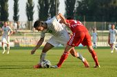 KAPOSVAR, HUNGARY - AUGUST 4: Lorant Olah (in white) in action at a Hungarian National Championship
