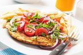 Frittata omelet with tomato and onion salad