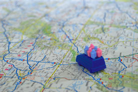 picture of family vacations  - Toy car with toy people on map suggesting a family vacation - JPG