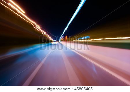 Fast car through city