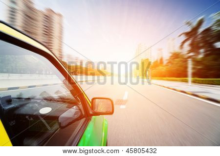 car through city with motion blur
