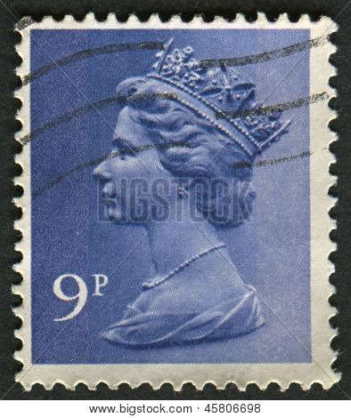UK-CIRCA 1976:A stamp printed in UK shows image of Elizabeth II is the constitutional monarch of 16 sovereign states known as the Commonwealth realms, in Deep Violet , circa 1976.