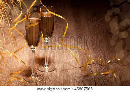 two glass with champagne on a wooden table