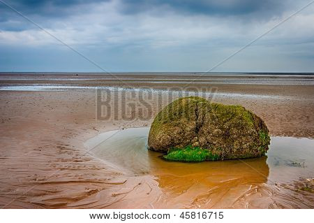 Lonely Stone On The Beach
