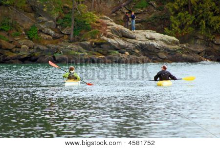 Two People In Two Kayaks