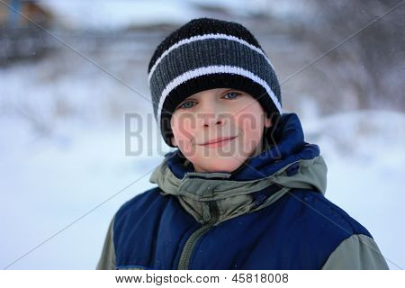 cute boy with frostbite on his cheeks