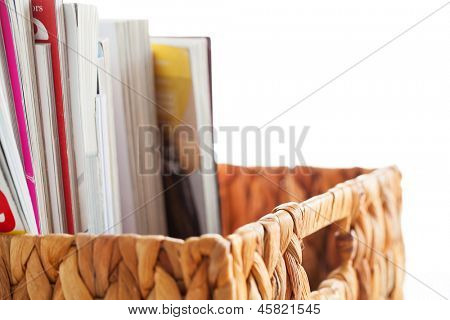 Closeup image of magazines in a straw pleated  box