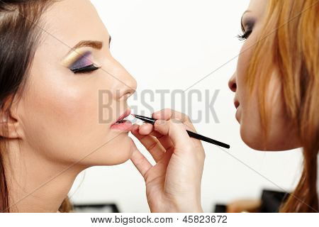 Beautiful Woman Having Makeup Applied By Makeup Artist