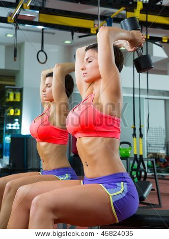 Crossfit fitness weight lifting Dumbbell woman at mirror workout exercise at gym