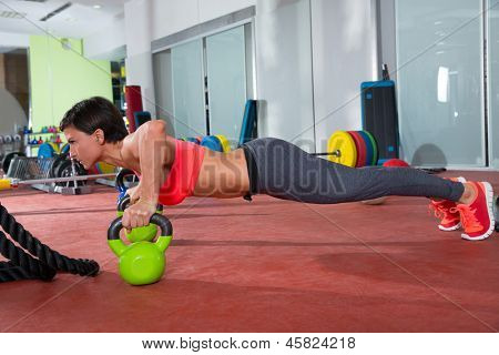 fitness woman push ups Kettlebells pushup exercise at gym workout