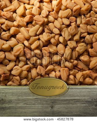 Fenugreek seeds  on Rustic wooden frame with golden label