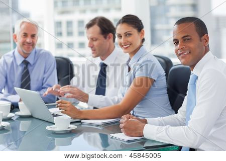 Smiling business people brainstorming  in the meeting room