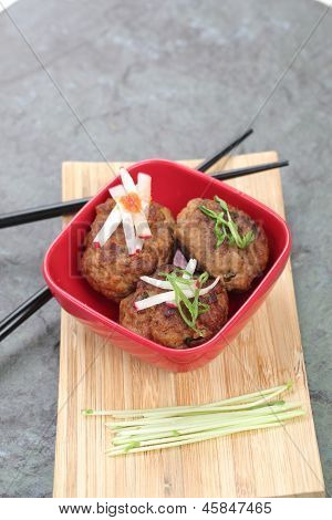 Asian Meatballs In A Red Bowl