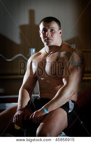 Young Powerlifter With Tattoo