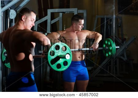 Pumped Guy Picking Up Heavy Barbell