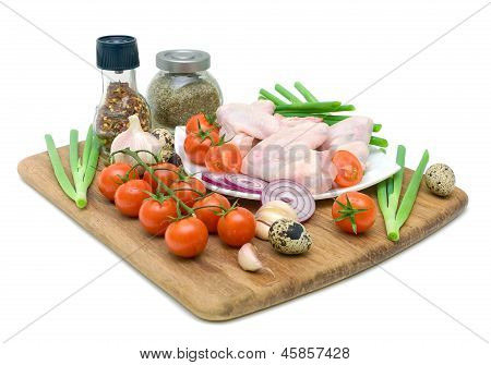 Fresh Vegetables, Quail Eggs And Raw Chicken Wings Isolated On White Background
