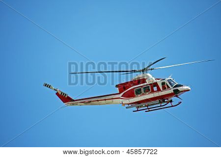 Patrol Helicopter Of Firefighters In Blue Sky Over A Fire 7