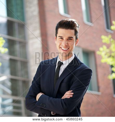 Businessman Standing Outside The Office With Arms Crossed