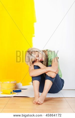 Exhausted Woman Taking A Break From Decorating