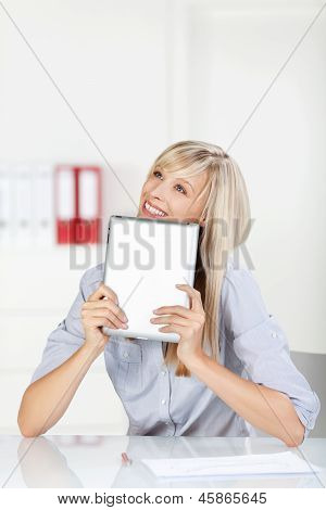 Daydreaming Female With Tablet