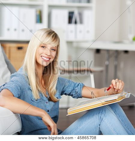 Smiling Woman With Folder At Home
