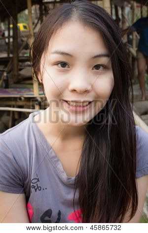 Portrait Of A Young Pretty Woman Smiling Outdoors