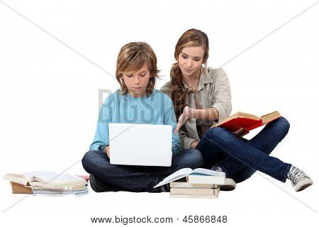 Two young people studying together