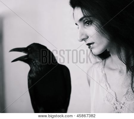 young woman with raven