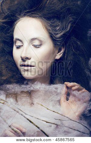 beauty woman with creative make up like cocoon
