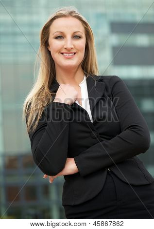 Cheerful Businessman Smiling Outside The Office