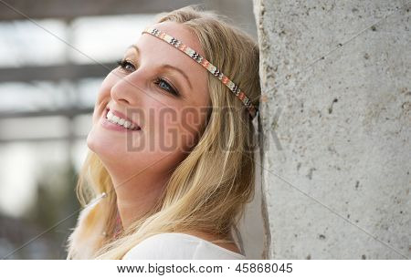 Portrait Of A Beautiful Young Woman Smiling Outdoors