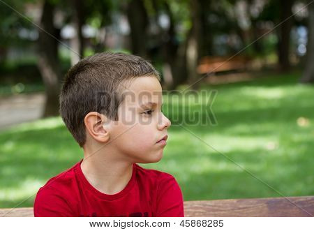 Sad Boy On A Park Bench