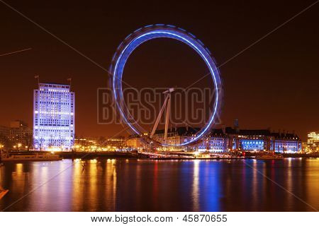LONDON, ENGLAND - MARCH 15: London Eye on March 15th, 2013 in London. The 135 meter landmark is a giant Ferris wheel situated on the banks of the River Thames in London, England.