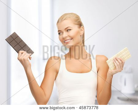 picture of smiling woman with dark and white chocolates