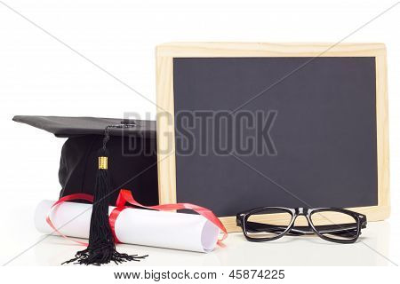 Blank blackboard with a scroll and a black hat