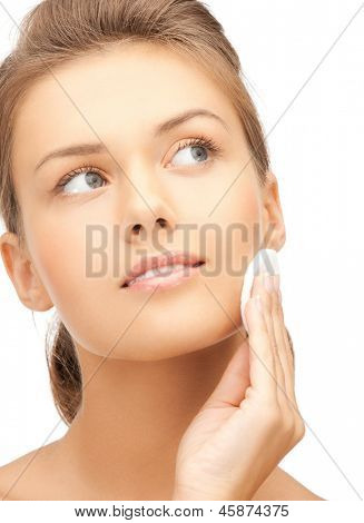 bright picture of beautiful woman with cotton pad