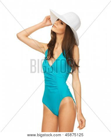 picture of model posing in swimsuit with hat.