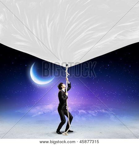 Businessman pulling banner