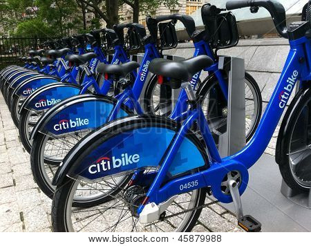 NEW YORK - MAY 24: Bicycles are shown docked at a Citibike sharing kiosk at Bowling Green Station on May 24, 2013 in New York. Operated by NYC Bike Share, thousands of bikes will be available.