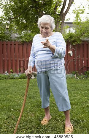Elderly Woman With Cane Shaking Finger
