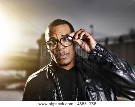 cool urban african american man  posing with gold sunlight