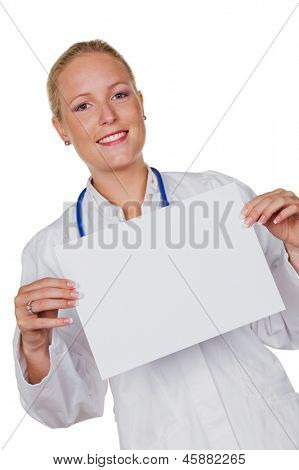 a young doctor with stethoscope in her doctor's office. holding a blank sign in his hand