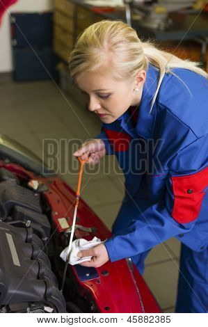 oil pressure is measured in the car. with the dipstick the correct oil level is checked