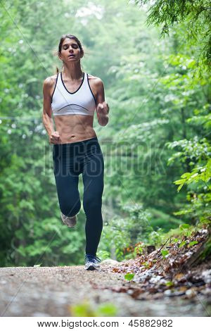 Middle Aged Woman Running On Dirt Road