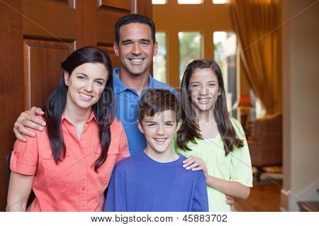 Family Standing In Entryway Of Home
