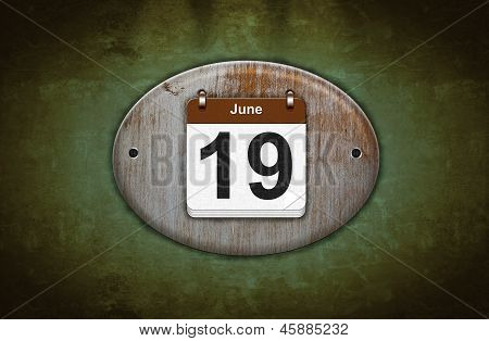 Old Wooden Calendar With June 19.
