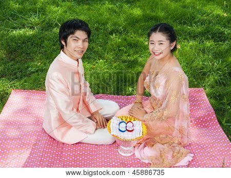 Asian Thai Bridal In Thai Wedding Suit With Wedding Rings